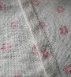 A French seam is enclosed within a fabric, hidden from view.