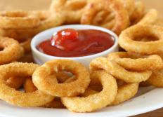 Onion rings may be cooked by pressure frying.