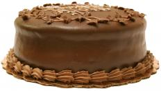A cake with chocolate fudge frosting.