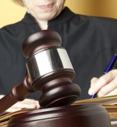 A judge may settle a dispute between parties in an adjudication.