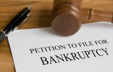 Legal bankruptcy is initiated through the filing of a court petition to gain debt relief.