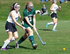 Field hockey is similar to soccer in that goals are scored, but players carry sticks.