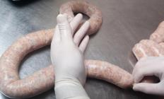 A butcher's apprentice may learn how to make sausages.