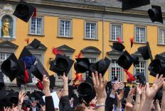 Students may receive diplomas at graduation ceremonies.