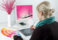 A graphic design apprentice working.