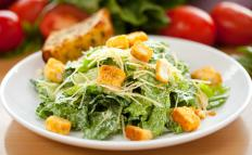 Romaine lettuce is often used as the base for Caesar salad.