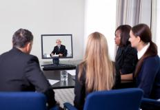 Group of businesspeople using telecommunications software in a web conference.