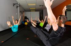 Pilates teachers ensure that students perform moves correctly.