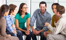 A mental health worker may help facilitate group therapy sessions.