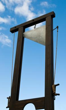 "The guillotine was invented as a quick, accurate way to decapitate a criminal. The euphemistic expression ""heads will roll"" suggests similar severe penalties."