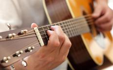 Many types of guitars are played with plectrums, or picks, although classical guitars are commonly played with just the fingers.