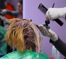 Double process hair coloring involves stripping the original color from the hair.