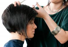 Stylists use thinning scissors to remove volume from thick, unruly, or very curly hair.