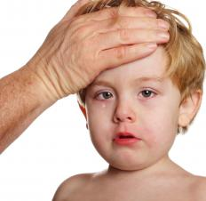 Symptoms of hand, foot and mouth disease may include fever, blisters in the mouth, and sore throat.