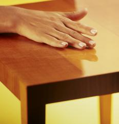 Polymer resins are often used to give furniture protective, glossy coatings.