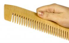 Wood combs are more expensive than plastic ones but considered healthier for hair.