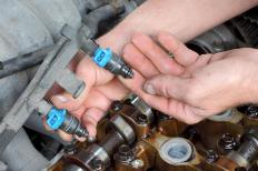 Cars use spark plugs for internal combustion.