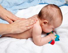 Baby oil can be used to massage restless infants.