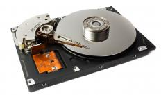 Hard disk drive with case removed to show the platters and the read-write head.