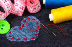 Adding decorative fabric to the top of a sewing project is known as applique.
