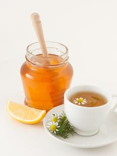 Warm tea with honey can help ease a sore throat.