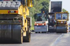 A tandem roller is used while paving roads and parking lots.