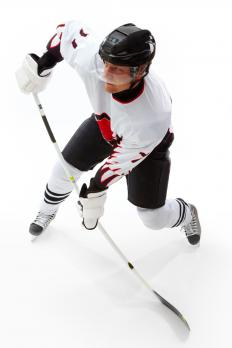 Hockey player preparing to shoot.