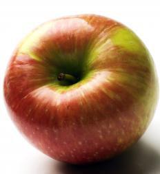 Honeycrisp apple are speckled red with green-gold patches.