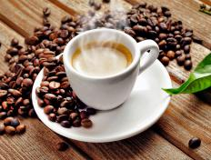 An espresso is made by forcing a small amount of extremely hot water through finely ground coffee beans.