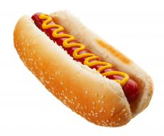 Foods that are high in fat and spices, like a hot dog with mustard, should be avoided by people with gastritis.
