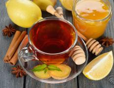 Hot tea with honey can help soothe a sore throat.