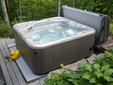 A prefabricated hot tub design may center on the wooden hot tub, or it may be a more common acrylic model.
