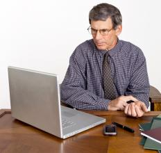 A hypochondriac taking his pulse while reading information about diseases online.