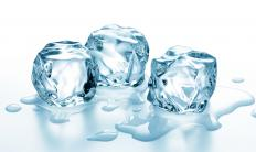 Placing ice cubes in hot liquid causes the ice to melt the liquid to cool.