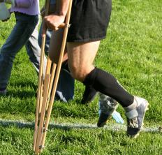 Physical therapists can help injured athletes grow accustomed to different aides, including crutches.