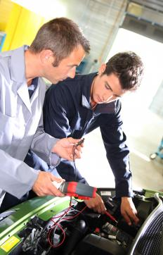 Mechanics conduct vehicle diagnostics to identify and assess vehicle problems.