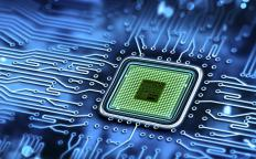 A radio frequency integrated circuit is seen in the form of a microchip.