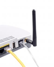 A broadband connection enters the modem and connects nearby wireless devices via an antenna.