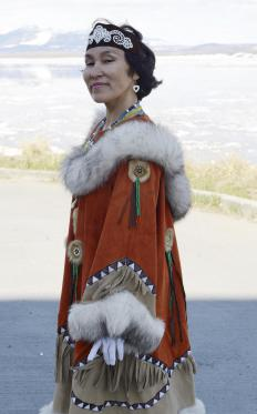 An Inuit woman wearing traditional clothing.