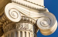 An Ionic column is characterized by its spiraled scroll design, called volutes.