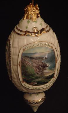 """The final line of the most well known Irish Blessing is, """"May God hold you in the hollow of His hand,"""" as displayed on this ornament."""
