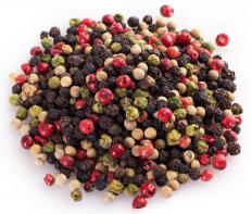 Peppercorns are dried and used as a seasoning, commonly found in peppermills, among other types of peppercorns.