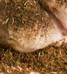Dry rubs are typically used to flavor rotisserie lamb and other rotisserie meats before cooking.
