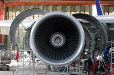 Jet engines, such as turbofans, are a type of gas turbine engine, as the air that is drawn in through their intakes is compressed, mixed with fuel, and ignited to drive a turbine.