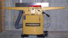 A jointer with a dust collection hose.