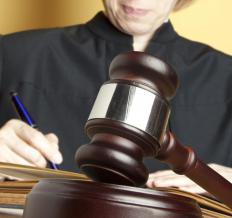 A judge hears and decides cases impartially in a court of law.