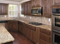 Kitchen with round cabinet knobs.