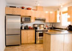 Kitchen with stainless steel drawer pulls.