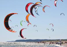 Kitesurfing is also known as kiteboarding, and is an exciting, popular sport in many seaside cities.