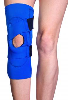 With knee tendonitis, doctors often recommend wearing a knee brace during sports to help stabilize the joint.